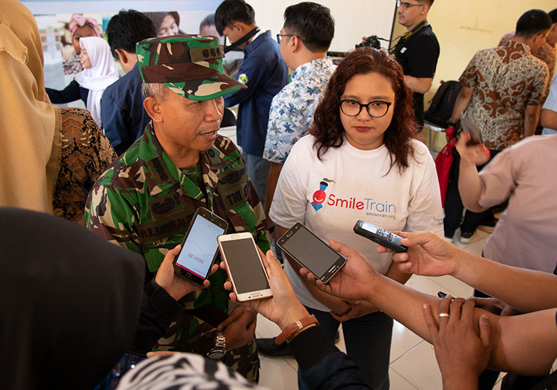 Deasy Larasati fields questions from the media along with a member of the Army