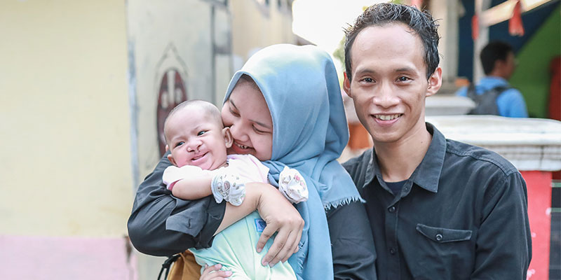 Rinda big smile with family